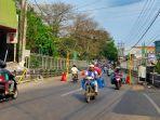 sejumlah-kendaraan-saat-melewati-jembatan-di-jalan-muharto-kota-malang.jpg