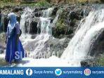 sejumlah-wisatawan-mulai-mengunjungi-dam-licin-sungai-dhompo-di-kecamatan-kraton-pasuruan.jpg