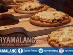 street-pizza-dengan-lima-varian-yang-bisa-dipesan-di-coffe-cafe-mercure-grand-mirama-surabaya.jpg