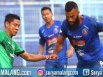 striker-arema-fc-sylvano-comvalius-bek-bhayangkara-fc-indra-kahfi.jpg