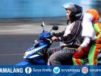 tanpa-helm-penjemput-bersepeda-motor_20180814_235527.jpg