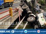 truk-trailer-masuk-sungai-di-tuban_20180914_122244.jpg