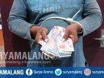 uang-curian-yang-disita-polisi-di-desa-salamrejo-kecamatan-binangun-kabupaten-blitar.jpg