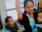 wanita-berdiri-sambil-gendong-anak-di-bus_20170628_154746.jpg