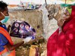wanita-di-somalia-saat-menerima-penyuluhan-petugas-tentang-covid-19-virus-corona.jpg