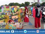 warga-foto-selfie-dengan-latar-belakang-kampung-warna-warni-di-kota-malang_20170702_145520.jpg