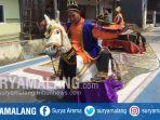 warga-menarikan-kesenian-jaran-bunot-di-desa-mulyoagung-dau-kabupaten-malang_20180815_170159.jpg