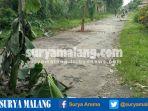 warga-tumpang-tanam-pohon-pisang-di-jalan-rusak_20170210_185120.jpg