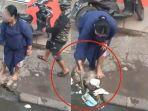 viral-video-emak-emak-masukan-sampah-ke-lubang-selokan-saat-banjir.jpg