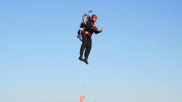Ilustrasi seorang pria naik jetpack