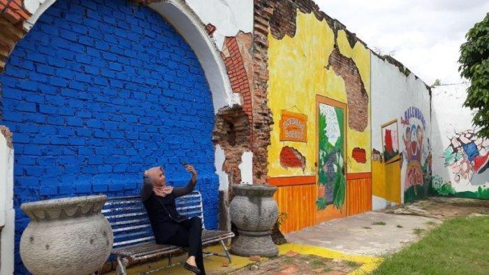Intip Kreasi Lukisan di Wisata Kampung Mural di Goedang Boencit Tepian Sungai Musi Palembang