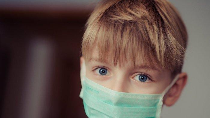 Ilustrasi anak laki-laki memakai masker