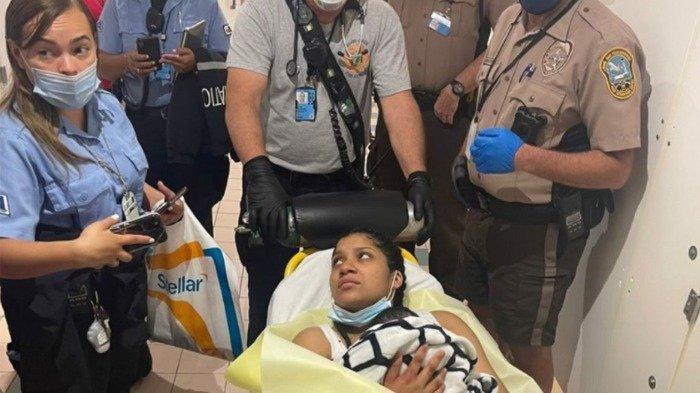 Seorang wanita yang melahirkan anaknya di Bandara Internasional Miami