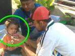 bayi-yang-ditemukan-di-parit-pasca-gempa-dan-tsunami-di-palu_20181001_212415.jpg