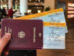 boarding-pass-pesawat-dan-paspor.jpg