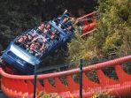 ilustrasi-pengunjung-naik-roller-coaster.jpg