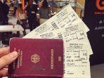 paspor-dan-boarding-pass-maskapai.jpg