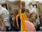 penumpang-pesawat-yang-dijemput-petugas.jpg