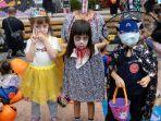 seorang-gadis-dengan-kostum-hantu-tanpa-kepala-untuk-rayakan-halloween.jpg