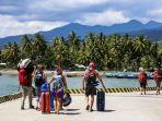 wisatawan-mancanegara-di-lombok-utara_20180809_113057.jpg
