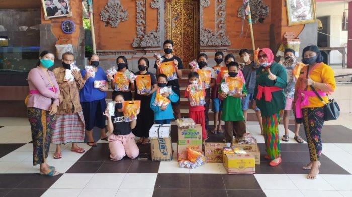 Peduli Covid-19, Lapas Perempuan Denpasar Sumbang 100 Masker Kain dan Kuliner ke Panti Asuhan