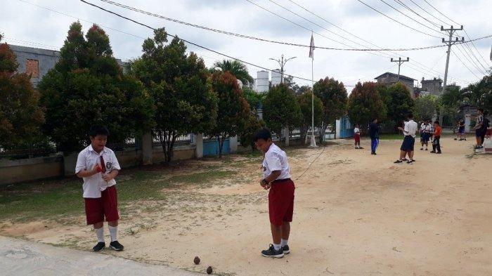 Lama Menghilang, Permainan Tradisional Gasing Kembali Ramai Dimainkan di Tanjab Barat