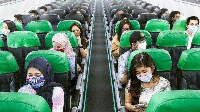 Apakah Masker Efektif Cegah Penularan Covid-19 di Pesawat? Ini Penjelasannya