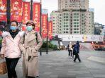 warga-china-mengenakan-masker-mengantisipasi-penyebaran-corona.jpg