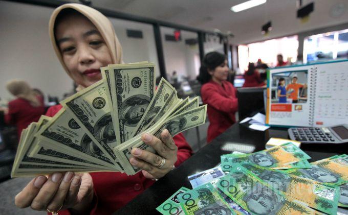 Sore Ini Rupiah Ditutup Melemah ke Level Rp 14.179 Per Dolar AS
