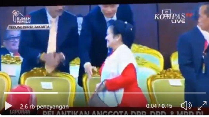 Kogasma Partai Demokrat, Agus Harimurti Yudhoyono (AHY) terlihat berusaha meraih tangan Ketua Umum Megawati Soekarnoputri untuk bersalaman, namun Mega terlanjur berpaling. Momen itu terekam dalam acara pelantikan anggota DPR, Selasa (1/10/2019).