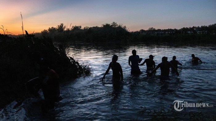 Berita Foto : Melihat Upaya Imigran Haiti Menghindari Deportasi AS - as-deportasi-ribuan-imigran-haiti_20210920_200936.jpg