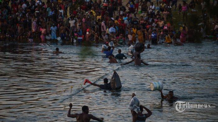 Berita Foto : Melihat Upaya Imigran Haiti Menghindari Deportasi AS - as-deportasi-ribuan-imigran-haiti_20210920_201201.jpg