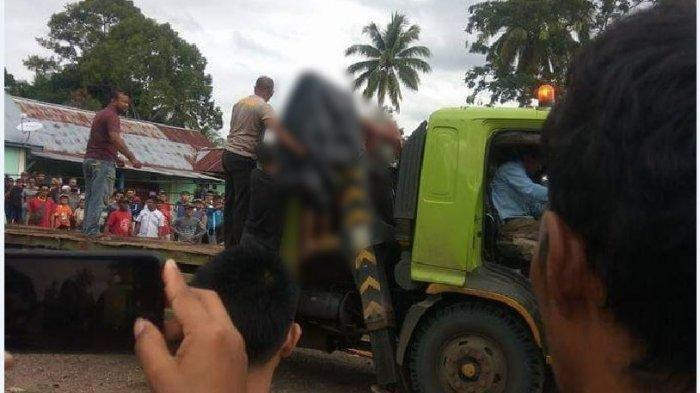 Awaluddin (56) warga Kalidoni Palembang Sopir kendaraan Fuso jenis Trailer tewas terjepit saat hendak menaikan alat berat Pemadat Aspal l, Minggu (5/1/2020) sekira pukul 15.00.