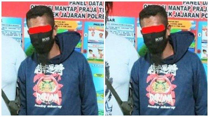 Pelaku diapiti anggota Reskrim Polres Malaka saat diamankan di Mapolres Malaka, Rabu (30/6/2021).