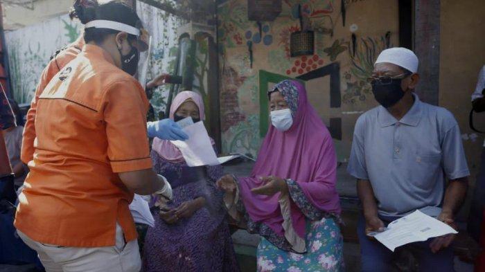 Penyaluran Bantuan Sosial Tunai di Kota Surabaya Dilakukan Cara Door to Door