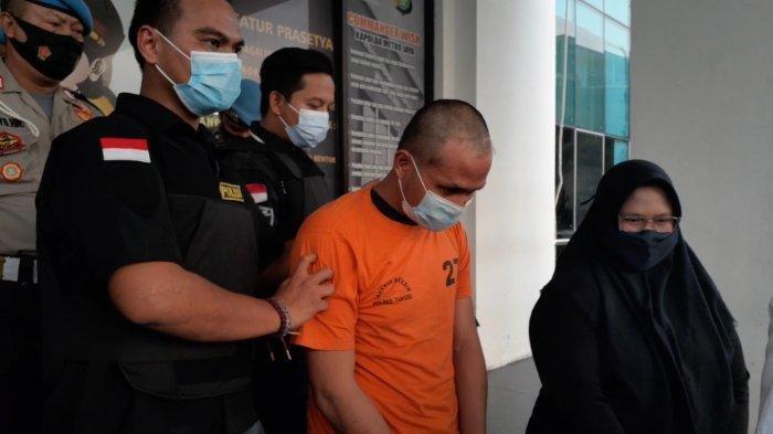Djodi, tersangka kasus penganiayaan saat gelar rilis di Mapolres Tangsel, Serpong, Kamis (22/4/2021).