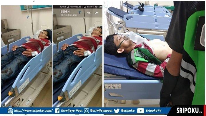 Heri Krisman (33) driver ojek online terbaring lemah di IGD RS Pelabuhan Palembang karena jadi korban penusukan penumpangnya, Senin (22/7/2019). TRIBUN SUMSEL/SHINTA ANGRAINI, HANDOUT