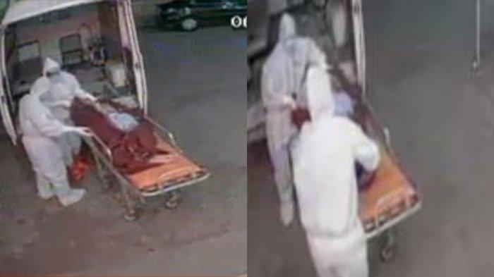 Dua petugas berpakaian APD lengkap terekam sedang membuang jenazah pasien Covid-19 di trotoar jalanan di India.