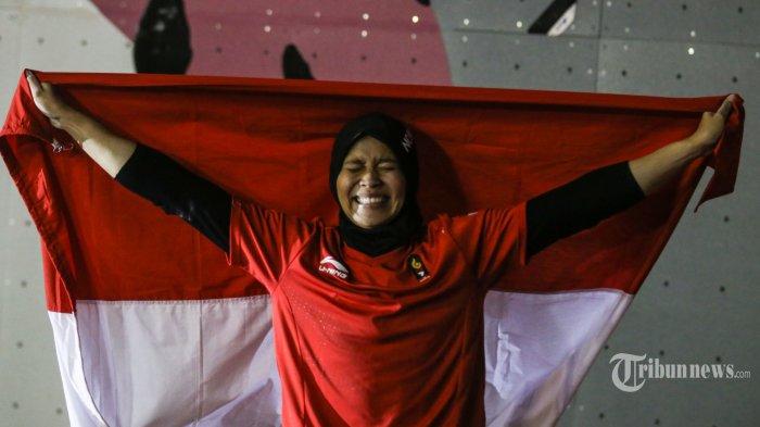 Aries Susanti Rahayu atlet panjat tebing Indonesia berhasil meraih emas Asian Games 2018 di nomor speed putri perorangaan di Venue Panjat Tebing JSC Palembang, Kamis (23/8/2018). Sriwijaya Post/Igun Bagus Saputra