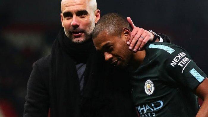 Fernandinho bersama Pep Guardiola di Manchester City