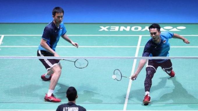 Ganda putra Indonesia Hendra Setiawan/Mohammad Ahsan saat berlaga di Jepang Open 2019.