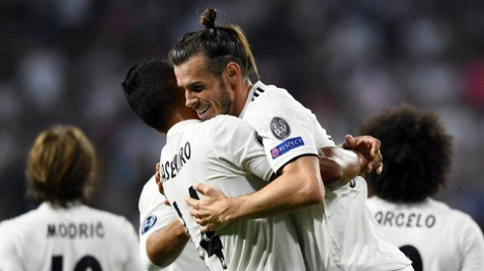Winger Real Madrid, Gareth Bale, melakukan selebrasi setelah menjebol gawang AS Roma pada laga Liga Champions di Santiago Bernabeu, Rabu (19/9/2018)