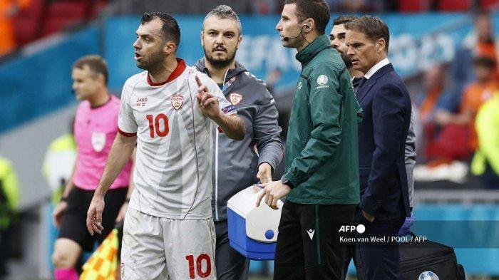 Penyerang Makedonia Utara Goran Pandev bereaksi terhadap gol pertama Belanda pada pertandingan sepak bola Grup C UEFA EURO 2020 antara Makedonia Utara dan Belanda di Johan Cruyff Arena di Amsterdam pada 21 Juni 2021.