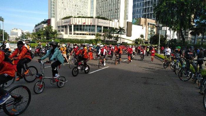 PDI Perjuangan menggelar 'Gowes Bareng PDIP' di kawasan Jakarta Pusat, Minggu (28/2/2021).