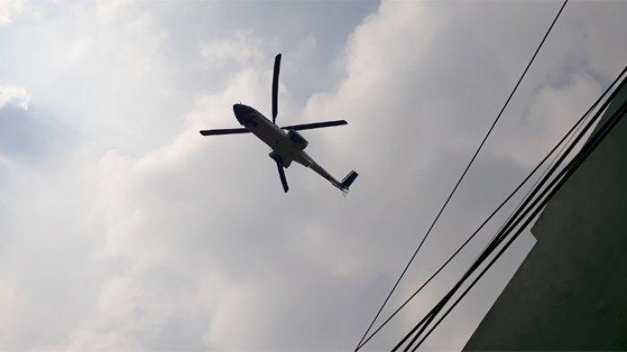 Tiga unit helikopter turut bersiap di acara pelantikan presiden dan wakil presiden periode 2019-2024 di Komplek Gedung Parlemen Senayan, Jakarta Pusat, Minggu (20/10/2019).