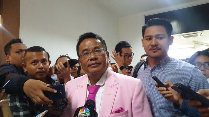 Hotman Paris Hutapea, pengacara Grab di sidang pemeriksaaan dugaan pelanggaran persaingan usaha di KPPU, Jakarta, Selasa (8/10/2019).