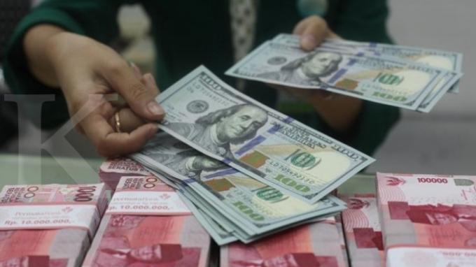 ILUSTRASI. Rupiah Menguat ke Rp 14.063 per Dolar AS, Kamis 18 Juni 2020, Ini Pergerakan Mata Uang Asing di Asia.