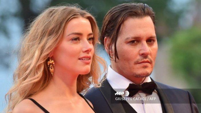 Aktor AS Johnny Depp dan istrinya,  Amber Heard, tiba untuk pemutaran film