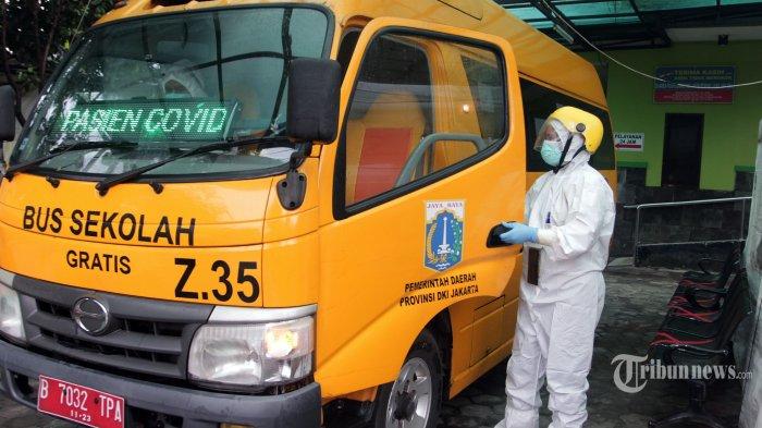 Gunakan APD Level 3, Awak Bus Sekolah Sudah Evakuasi 13.954 Pasien Covid-19,