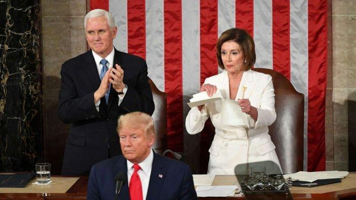 Vice President Mike Pence claps as Speaker of the House Nancy Pelosi rips a copy of President Donald Trump speech after he delivers the State of the Union address at the US Capitol in Washington, Feb. 4, 2020.Vice President Mike Pence claps as Speaker of the House Nancy Pelosi rips a copy of President Donald Trump speech after he delivers the State of the Union address at the US Capitol in Washington, Feb. 4, 2020.